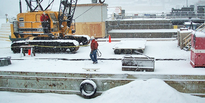 Cold weather construction, marine construction, barge snow, dam construction