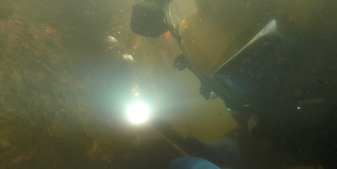 Underwater welding, commercial diving, marine construction, dock construction, barge terminal repairs