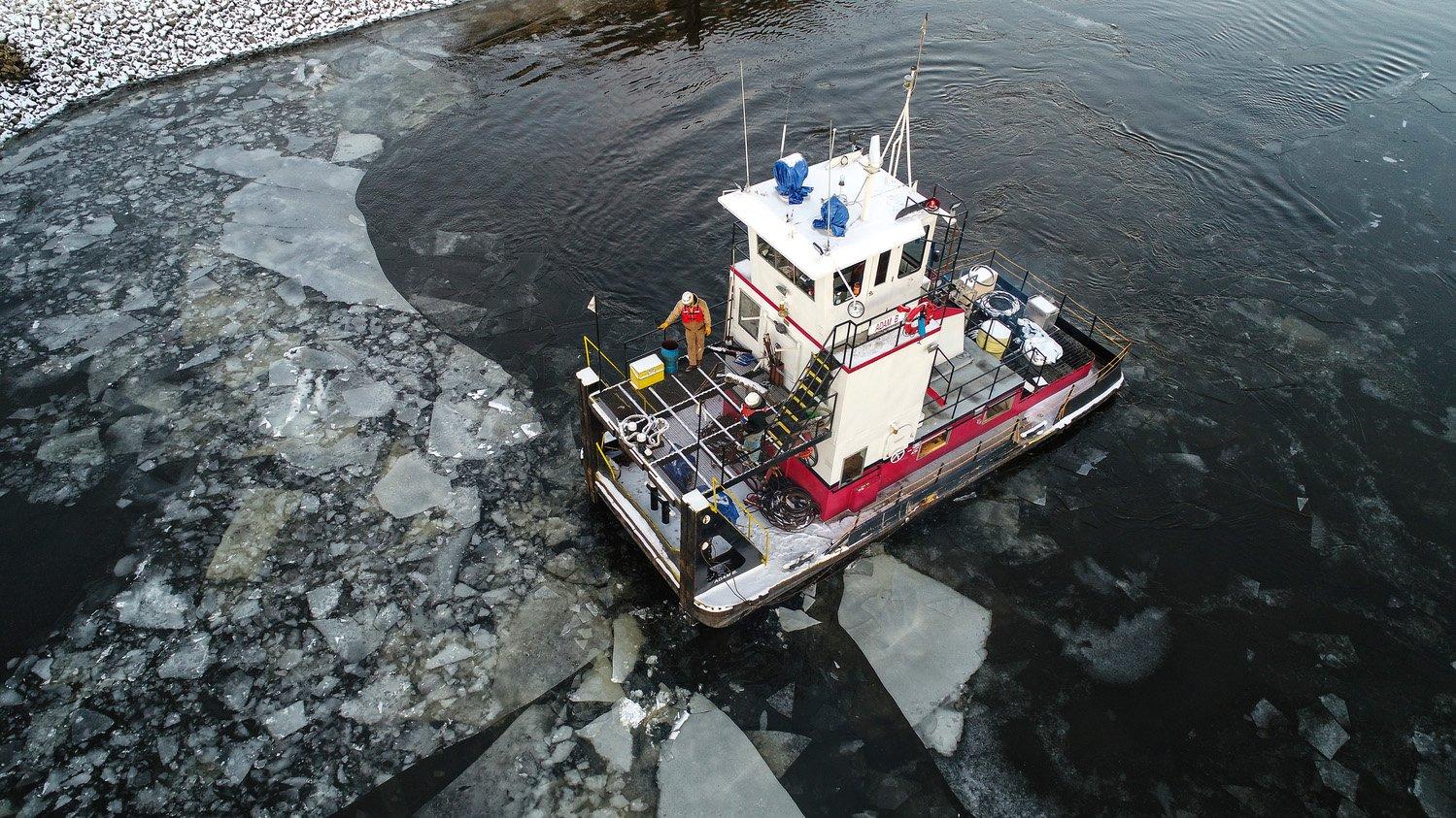 Brennan's team travels in an ice filled waterway
