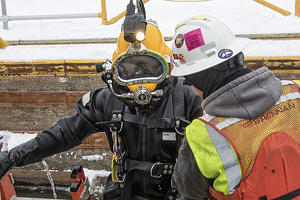 Close up of Brennan diver and safety team