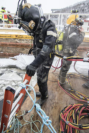 Under ice diver preparing to enter the cold water