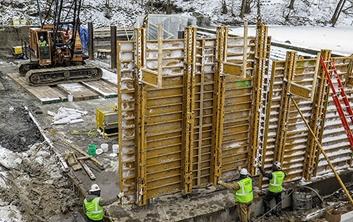 dam construction, concrete placement, winter construction, winter concrete placement, water retainage structures, dam construction contractors