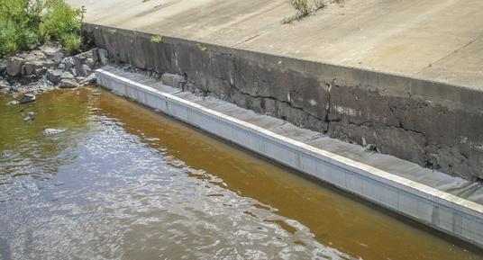 vinyl sheet piling, leave in place formwork, concrete protection, dam construction, dam repairs, midwest dam repairs, dam contractors