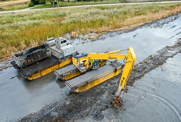 amphibious dredging, wetland remediation, marsh restoration, marsh dredging