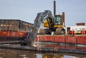 mechanical dredging equipment on river