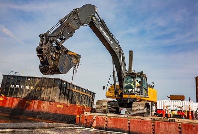 mechanical dredging, environmental dredging, precise mechanical dredging, environmental remediation, remedial dredging, barge transport