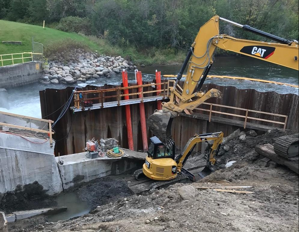 Excavation downstream of permanent sheeting wall