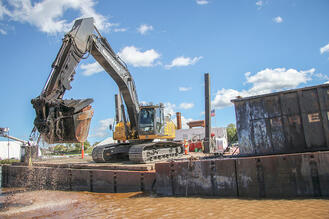 Brennan moving mechanically dredged material into a material barge