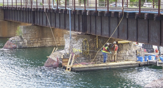 railroad pier repairs, railroad bridge construction, railroad pier construction, railroad bridge repairs, pier and abutment repairs