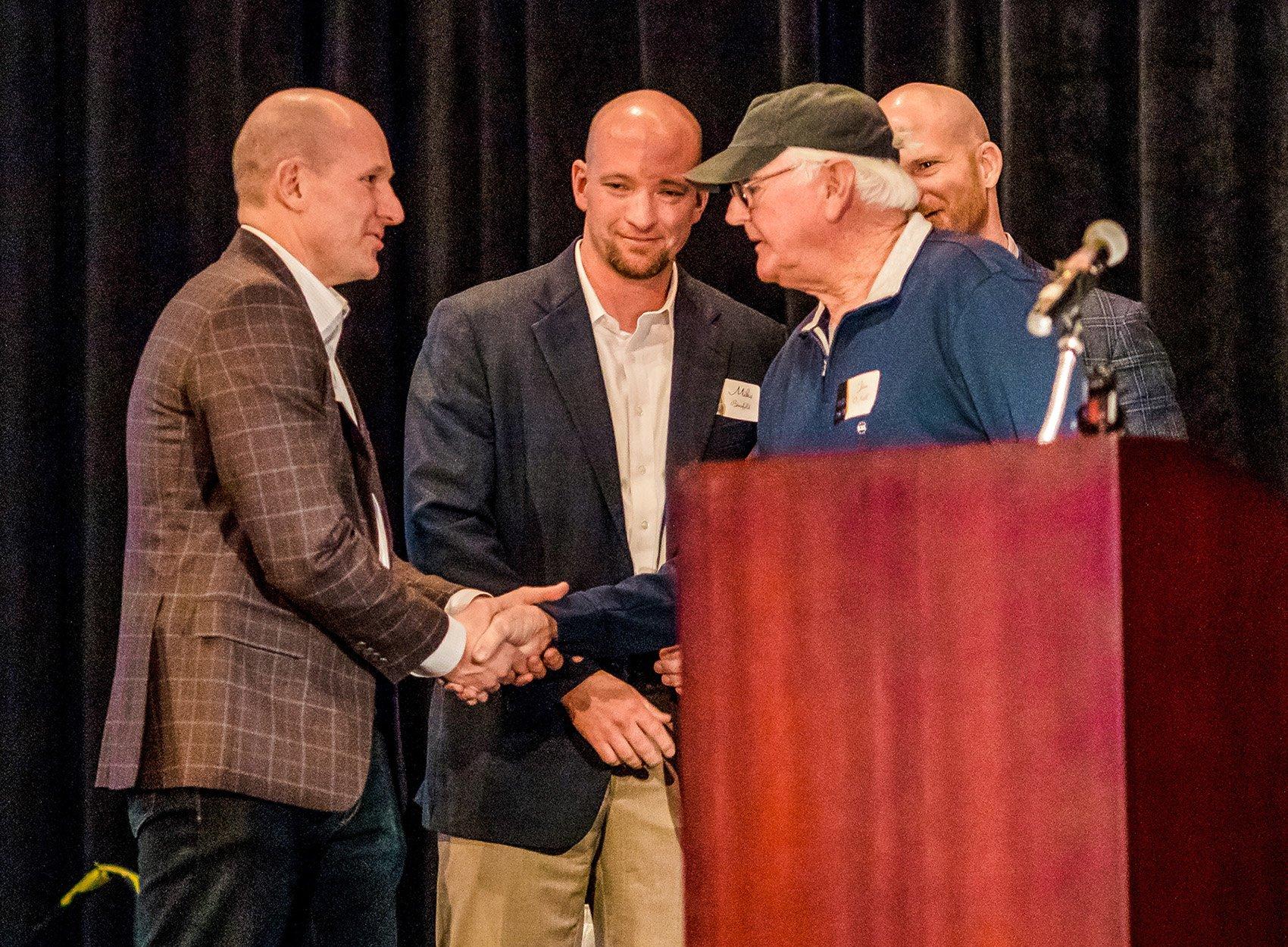 Resized 2019 Brennan 100th Anniversary_Matt Binsfeld, Mike Binsfeld, Jim ONeill, and Adam Binsfeld
