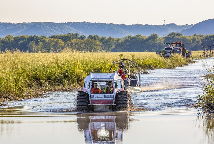 Sherp ATV and Airboat behind it onsite