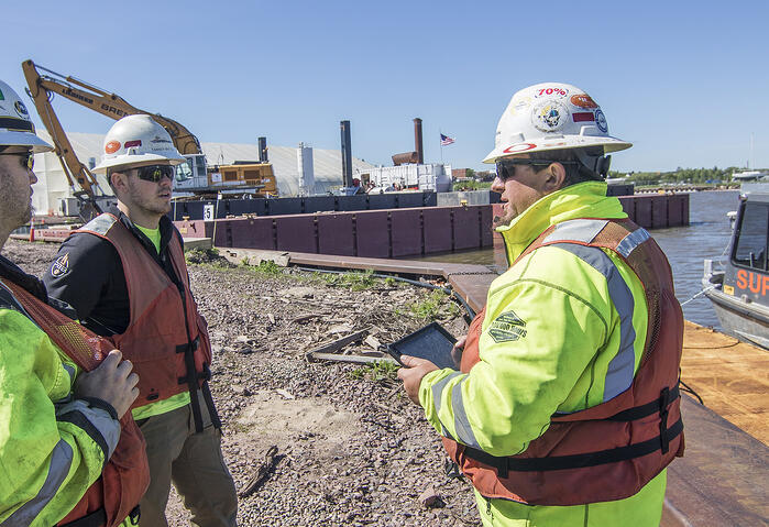 Safety meeting on site with tablet