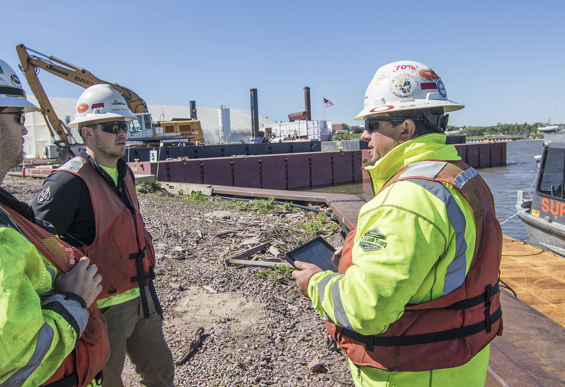 Onsite safety meeting with tablet