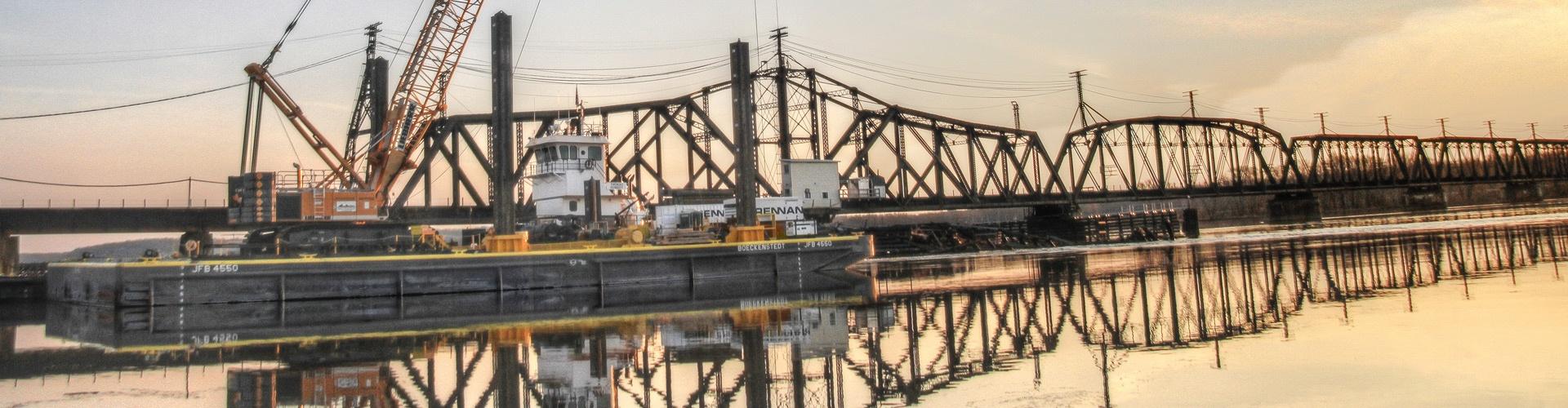 railroad construction services, railroad contractors, bridge replacements, bridge repairs, railroad bridge repairs, derailment assists, derailment cleanups, brennan,