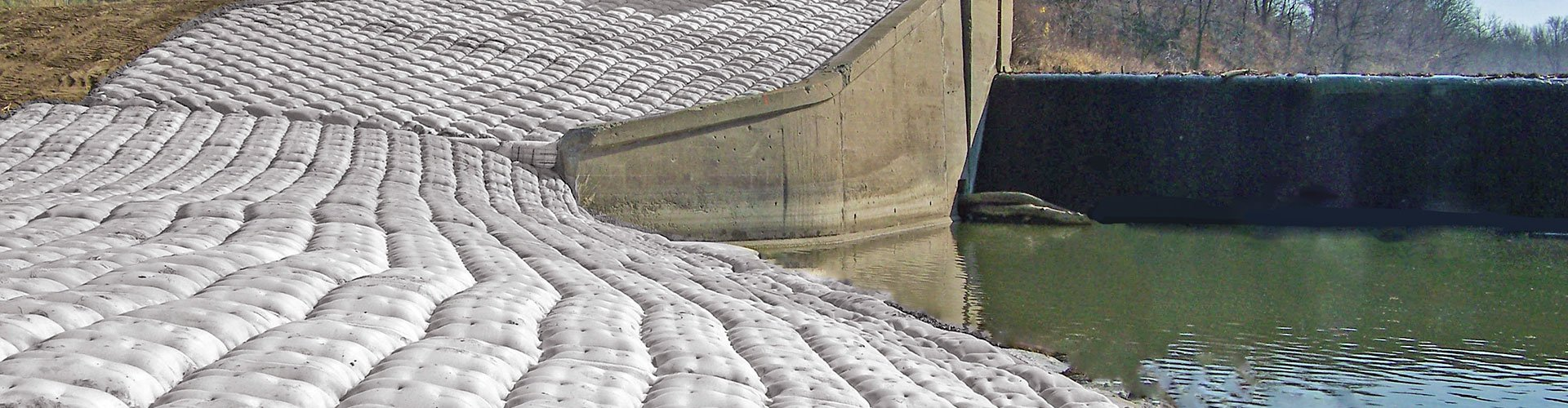 dam construction, scour remediation, scour control, fabric formed articulating block mats
