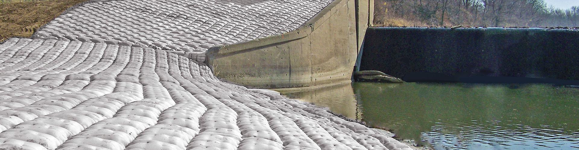 dam construction, scour remediation, scour control, fabric formed articulating block mats