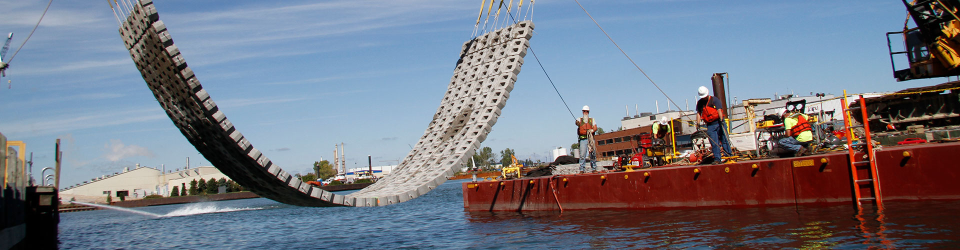 dam construction, underwater construction, articulating block mats, concrete block mats