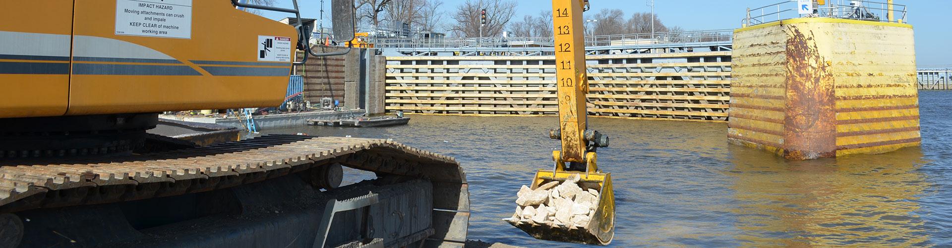 dam construction, rip rap, rip rap placement, scour control, scour remediation
