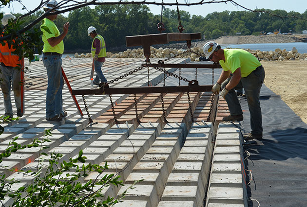 Dam-Construction, scour and erosion remediation, precast concrete articulating block mats, precast articulating block mats