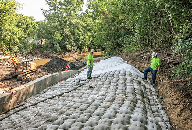 dam construction, cast in place articulating block mats, fabric formed articulating block mats, scour remediation, erosion control