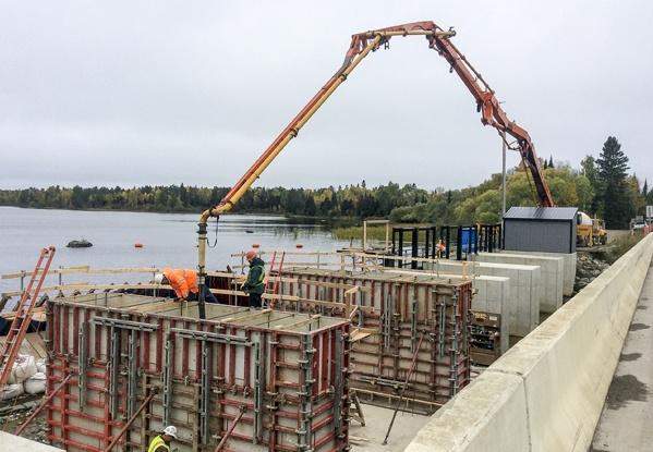dam construction, concrete placement, mass pours, preplaced aggregate concrete