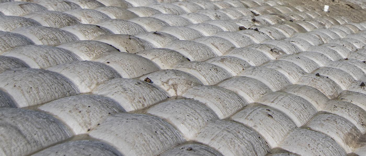 Environmental Sand covers, rock placement, engineered caps, scour protection, insitu caps, environmental remediation, subaqueous caps, broadcast capping system, GAC caps, sand caps, aquagate, organoclay, cast in place articulating block mat