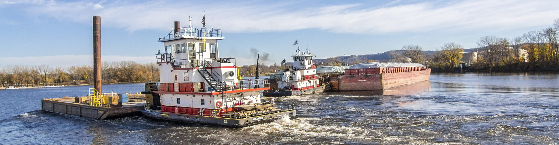 switching and fleeting, fleeting, barge transportation, inland waterway services, inland river services, inland river towing, towboats, Upper Mississippi river service, barge service, harbor management