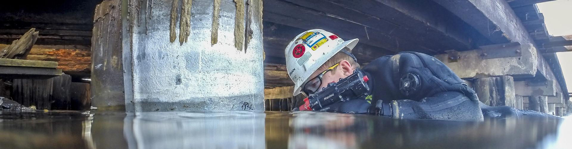 underwater construction, underwater pier repairs, bridge pier repairs, pier repairs, concrete repairs, pile jackets