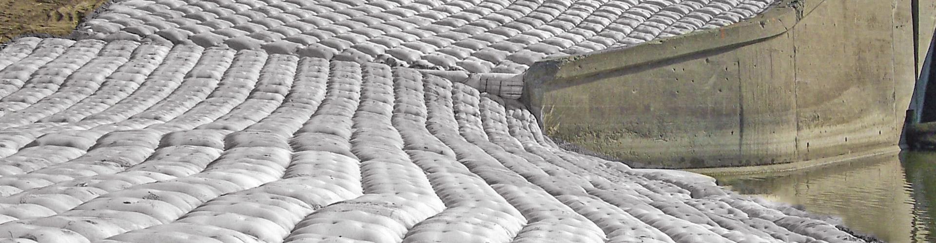 bridge scour, scour remediation, articulating block mat, fabric formed articulating block mat, cast in place mat, unimat