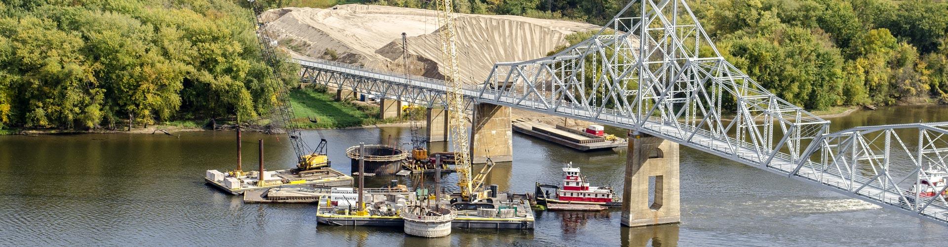 bridge construction, bridge repair, pier repairs, underwater pier repairs, marine construction, marine support, concrete repairs, scour repairs, bridge protection cells