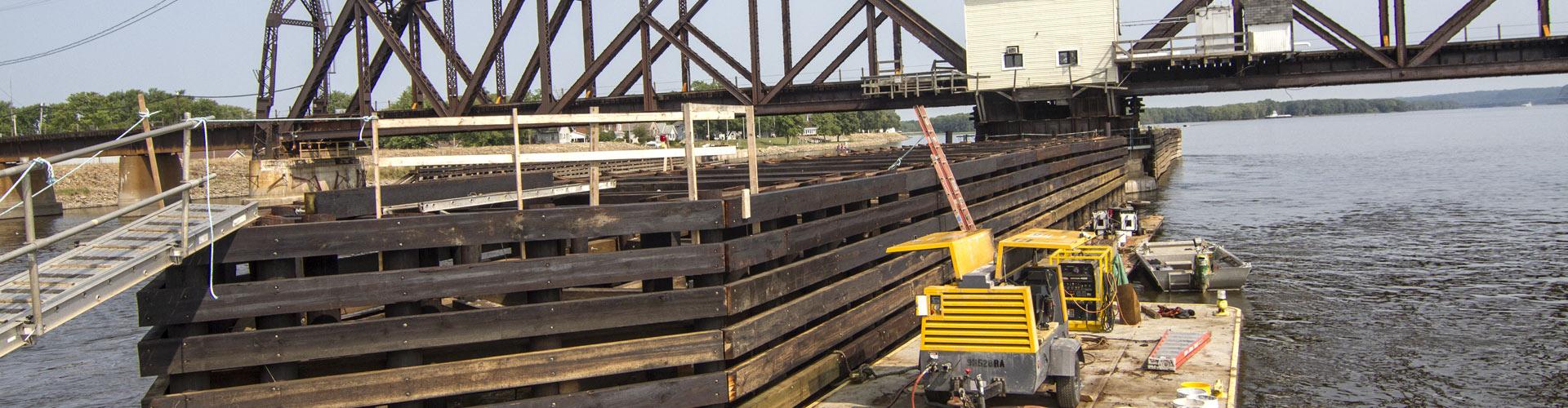 bridge demolition, timber cribbing repairs, railroad bridge fender systems, railroad bridge repairs, railroad contractor