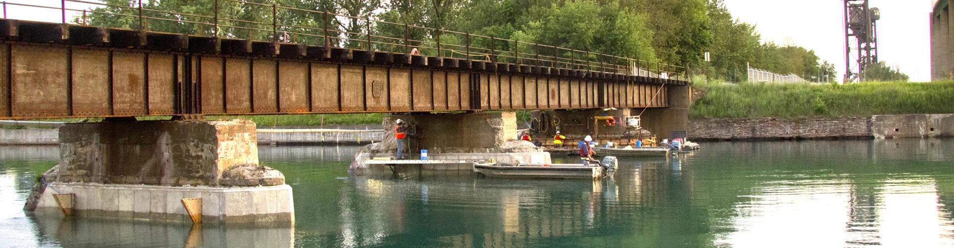 underwater construction, preplaced aggregate concrete, grouting, railroad bridge repairs, bridge repairs