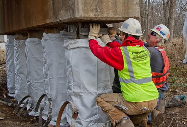 pile jacket repairs, railroad bridge pier repairs, pile jackets, fabric formed pile jackets, pier restoration, bridge construction, railroad bridge construction and repair