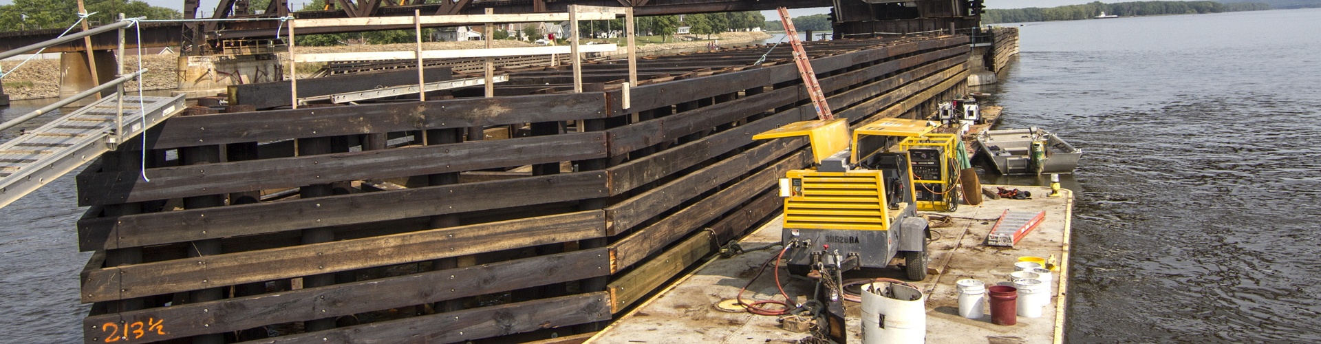 timber cribbing, bridge protection systems, railroad bridge protection, navigation protection