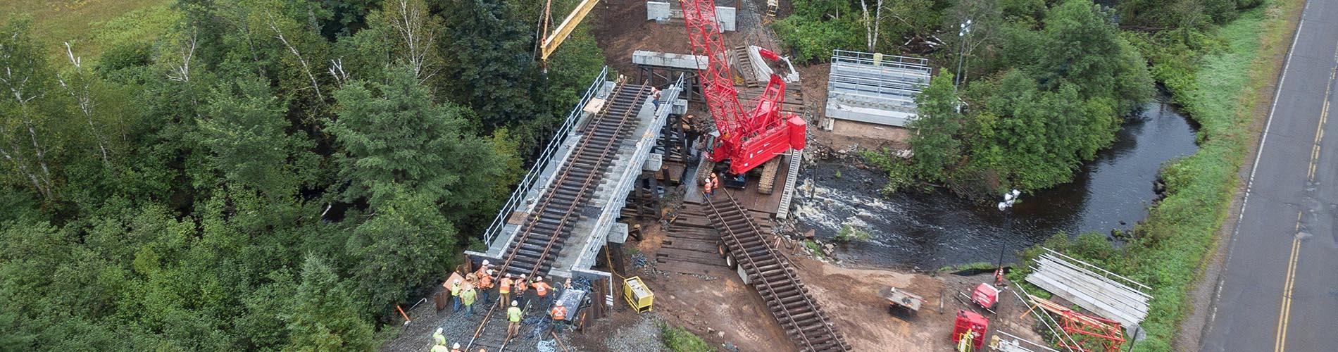railroad construction services, railroad contractors, bridge replacements, bridge repairs, railroad bridge repairs, derailment assists, derailment cleanups,