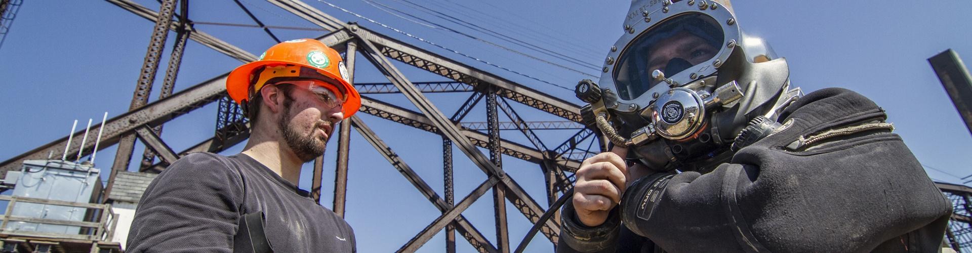 railroad construction services, underwater construction, underwater inspections, railroad bridge inspections, railroad bridge construction, pier repairs, underwater pier repairs