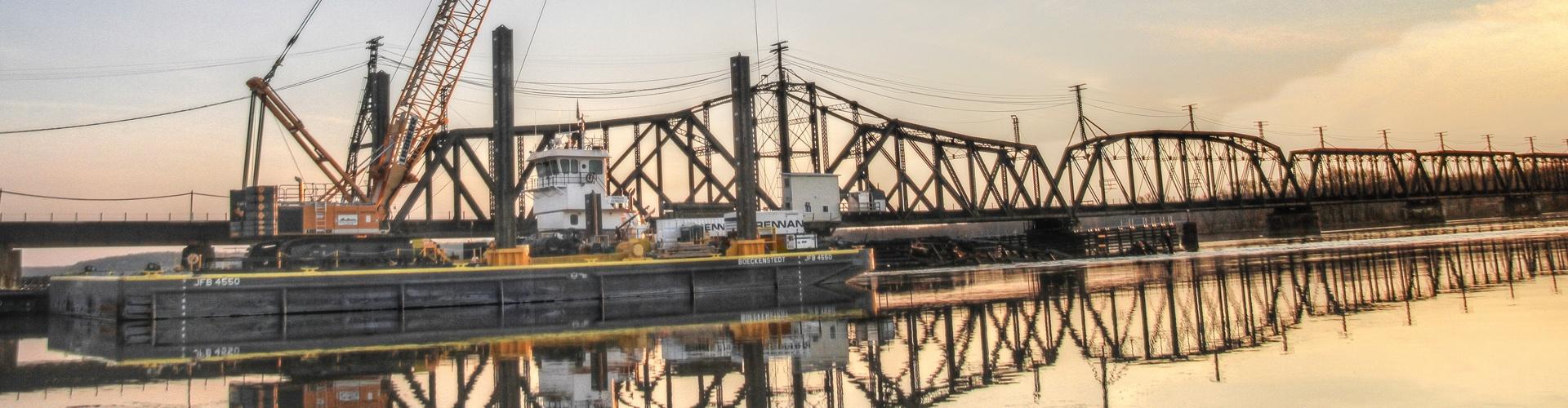 marine support, barge construction, railroad construction services, railroad contractors, bridge replacements, bridge repairs, railroad bridge repairs, derailment assists, derailment cleanups,